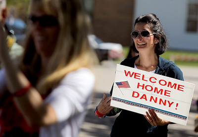 Sarah Nader - snader@shawmedia.com Deborah Webster of Huntley helps to welcome home Army Sgt. Daniel Bacino on Sunday, September 9, 2012. Bacino had been in the Army for the past four years and has served tour tours in both Iraq and Afghanistan.
