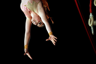 Sarah Nader - snader@shawmedia.com The Delara Duo performs an airborne act during the Kelly Miller Circus at Milky Way Park in Harvard on Sunday, September 9, 2012.