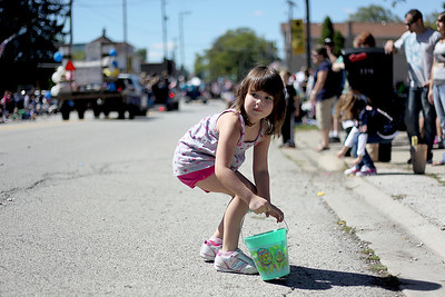 Sarah Nader - snader@shawmedia.com Vivian Nilles, 5, of Johnsburg picks up candy during the Saufen und Spiel parade in Johnsburg on Sunday, September 9, 2012.