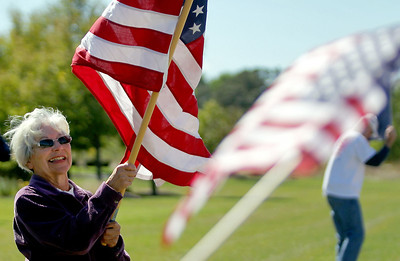 Sarah Nader - snader@shawmedia.com Arleen Terdina of Huntley waves an American flag while participating in the Now or Never Rally put on by the Huntley area TEA Party on the corner of Del Webb Boulevard and Route 47 in Huntley on Saturday, September 8, 2012.