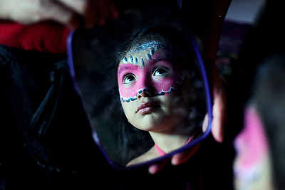 Sarah Nader - snader@shawmedia.com Alisson Paez, 3, of Harvard checks out her face after getting a mask face painted on while attending the Kelly Miller Circus at Milky Way Park in Harvard on Sunday, September 9, 2012.