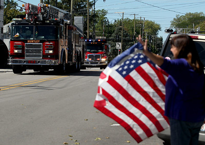 Sarah Nader - snader@shawmedia.com Huntley fire trucks and the Patriot Guard Riders escorted Army Sgt. Daniel Bacino to the Huntley Town Square on Sunday, September 9, 2012. Bacino had been in the Army for the past four years and has served tour tours in both Iraq and Afghanistan.