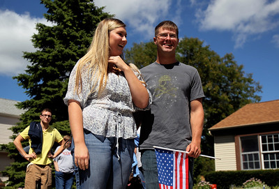 Sarah Nader - snader@shawmedia.com Lance Corporal Jacob Savage of McHenry and his fiancé, Paige Lewis of McHenry watch as the Warriors' Watch Riders pull up to welcome Savage home on Saturday, September 8, 2012. Savage  returned from his seven month tour in Afghanistan this week.