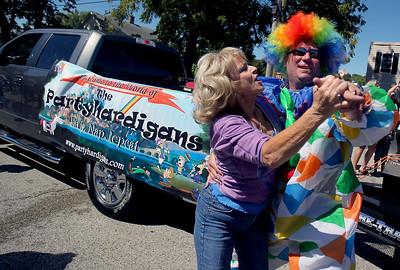 Sarah Nader - snader@shawmedia.com Chad Miller dances with Donna Swieton of Round Lake during the Saufen und Spiel parade in Johnsburg on Sunday, September 9, 2012.