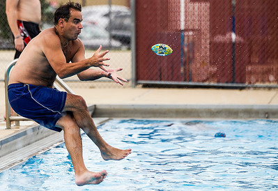 Kyle Grillot - kgrillot@shawmedia.com   On the final day of the pool season, Pat Reilly of Algonquin jumps to catch a ball at the Lions Armstrong Memorial Pool Sunday, September 1, 2013. As Labor day symbolizes the end of summer many spectators come out to enjoy a few more summer activities.