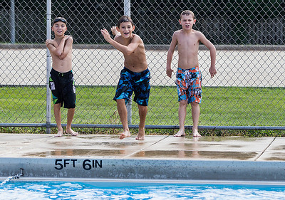 Kyle Grillot - kgrillot@shawmedia.com   On the final day of the pool season, Tyler Toms, 9, (from left) Dominick Poremba, 9, and Dylan Reilly, 10, wait as a ball is thrown to them at the Lions Armstrong Memorial Pool Sunday, September 1, 2013. As Labor day symbolizes the end of summer many spectators come out to enjoy a few more summer activities.