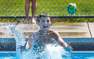 Kyle Grillot - kgrillot@shawmedia.com   On the final day of the pool season, Dominick Poremba, 9, of Algonquin jumps to catch a ball at the Lions Armstrong Memorial Pool Sunday, September 1, 2013. As Labor day symbolizes the end of summer many spectators come out to enjoy a few more summer activities.