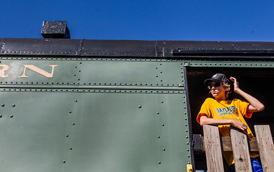 Kyle Grillot - kgrillot@shawmedia.com   Andrew Lee, 15, waits on a train car before departure during the final day of the Illinois Railway Museum's 60th anniversary extravaganza Monday, September 2, 2013. The rail museum  operates steam, diesel and electric trains, and features nearly 400 historic locomotives and rail cars.