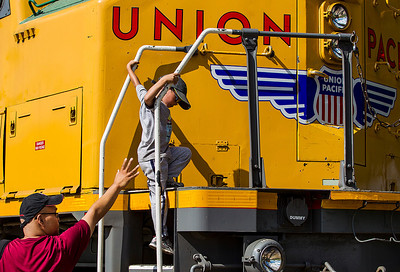 Kyle Grillot - kgrillot@shawmedia.com   Eugene Almazan of Hoffman Estates helps his son Alex, 6, down from a train during the final day of the Illinois Railway Museum's 60th anniversary extravaganza Monday, September 2, 2013. The rail museum  operates steam, diesel and electric trains, and features nearly 400 historic locomotives and rail cars.