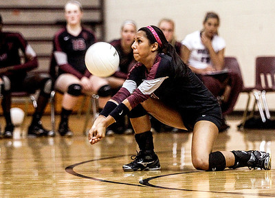 Sarah Nader -  snader@shawmedia.com Prairie Ridge's Stone Salerno returns the ball during Tuesday's volleyball game against Crystal Lake Central in Crystal Lake September 3, 2013. Crystal Lake Central won, 2-0.