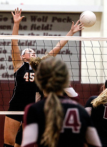 Sarah Nader -  snader@shawmedia.com Crystal Lake Central's Lauren Leverenz jumps to block the ball during Tuesday's volleyball game against Prairie Ridge in Crystal Lake September 3, 2013. Crystal Lake Central won, 2-0.