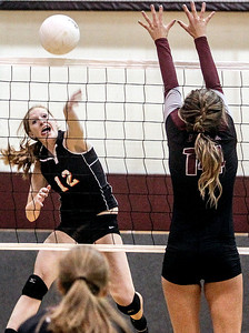 Sarah Nader -  snader@shawmedia.com Crystal Lake Central's Maddy Cysewski hits the ball over during Tuesday's volleyball game against Prairie Ridge in Crystal Lake September 3, 2013. Crystal Lake Central won, 2-0.