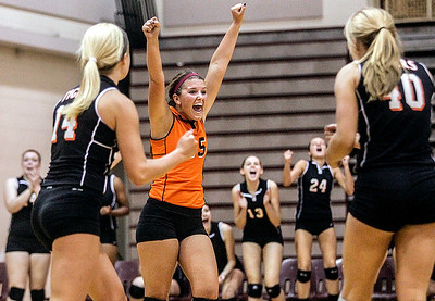 Sarah Nader -  snader@shawmedia.com Crystal Lake Central's Annie Fox celebrates a point during Tuesday's volleyball game against Prairie Ridge in Crystal Lake September 3, 2013. Crystal Lake Central won, 2-0.