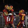 Jeff Krage – For Shaw Media<br /> Batavia's Jordan Zwart, left, is congratulated by Mike Moffatt after catching a touchdown pass in the second quarter of Saturday's game against visiting Glenbard North. <br /> Batavia 8/31/13