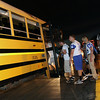 Jeff Krage – For Shaw Media<br /> St. Charles North football players enter a school bus after Friday's game at Elk Grove was cancelled due to lightning.<br /> Elk Grove 8/30/13