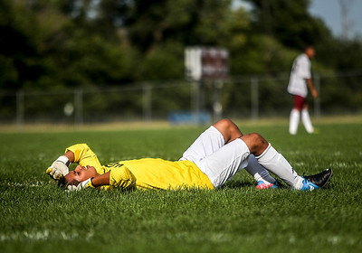 Sarah Nader -  snader@shawmedia.com Woodstock North's Ricky Rodriguez lays the on filed after getting hurt during Wednesday's soccer game against Marengo at Marengo High School September 4, 2013. Woodstock North won, 4-3.