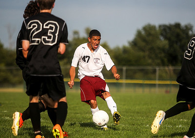 Sarah Nader -  snader@shawmedia.com Marengo's Romero Manriquez brings the ball down field during the first half of Wednesday's game against Marengo at Marengo High School September 4, 2013. Woodstock North won, 4-3.