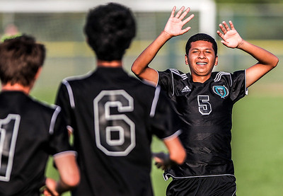 Sarah Nader -  snader@shawmedia.com Woodstock North's Esteban Albarran celebrates a goal with his teammates during the second half of Wednesday's soccer game against Marengo at Marengo High School September 4, 2013. Woodstock North won, 4-3.