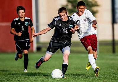 Sarah Nader -  snader@shawmedia.com Woodstock North's Josh Jandron (left) is guarded by Marengo's Romero Manriquez while he brings the ball down field during the first half of Wednesday's game at Marengo High School September 4, 2013. Woodstock North won, 4-3.