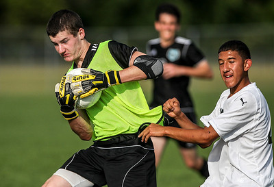 Sarah Nader -  snader@shawmedia.com Marengo' s Romero Manriquez (right) runs into Woodstock North's goalie Chris Niese during the second half of Wednesday's soccer game at Marengo High School September 4, 2013. Woodstock North won, 4-3.