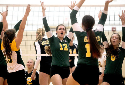 Sarah Nader -  snader@shawmedia.com Crystal Lake South's Nicole Slimko (center) celebrates a point with her teammate during Thursday's volleyball match against Jacobs at Jacobs High School September 5, 2013. Crystal Lake South won, 2-0.