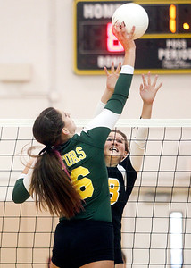 Sarah Nader -  snader@shawmedia.com Jacobs' Sarah Walsh (right) jumps to block a shot by Crystal Lake South's Carly Nolan during Thursday's volleyball match at Jacobs High School in Algonquin September 5, 2013. Crystal Lake South won, 2-0.
