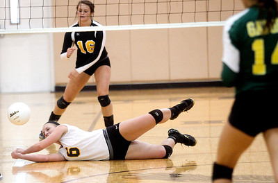 Sarah Nader -  snader@shawmedia.com Jacob's Kassie Kasper dives for the ball during Thursday's  volleyball match against Crystal Lake South at Jacobs High School September 5, 2013. Crystal Lake South won, 2-0.