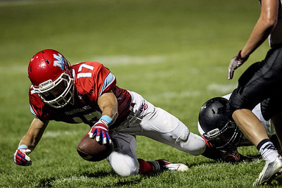 Sarah Nader -  snader@shawmedia.com Marian Central's Brett Olson is tackled during the second quarter of Friday's game against McHenry in Woodstock September 6, 2013. Marian Central defeated McHenry, 40-14.