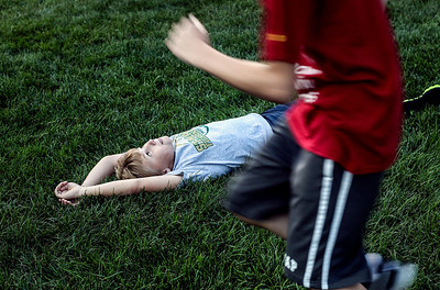 Sarah Nader -  snader@shawmedia.com Matthew Jablonski, 11, of Woodstock plays football with his friends before Friday's football at Marian Central September 6, 2013.