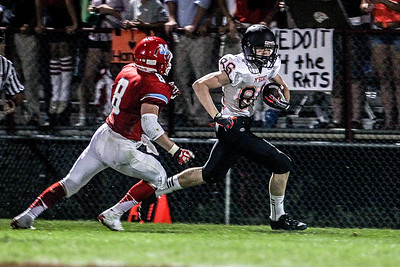 Sarah Nader -  snader@shawmedia.com Marian Central's Bailey Brown (left) runs after McHenry's Mike Borst during the third quarter of Friday's game in Woodstock September 6, 2013. Marian Central defeated McHenry, 40-14.