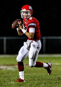 Sarah Nader -  snader@shawmedia.com Marian Central's quarterback Billy Bahl throws a pass during the second quarter of Friday's game against McHenry in Woodstock September 6, 2013. Marian Central defeated McHenry, 40-14.