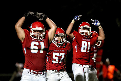 Sarah Nader -  snader@shawmedia.com Marian Central players, Josh Olsen (left), Shane Kirwan and Matt Ricchiuto pump up the during Friday's football game against McHenry September 6, 2013. Marian Central defeated McHenry, 40-14.