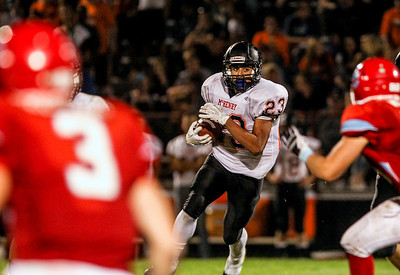 Sarah Nader -  snader@shawmedia.com McHenry's Jordan Johnson runs a play during the third quarter of Friday's game against Marian Central in Woodstock September 6, 2013. Marian Central defeated McHenry, 40-14.