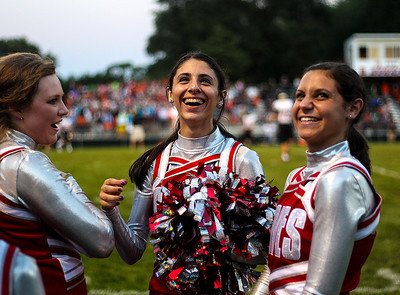 Sarah Nader -  snader@shawmedia.com Marian Central cheerleaders Jacqueline Tarzian (center)m 17, of  McHenry and Kate Wirkus, 17, of Dundee stand on the sidelines during Friday's football game against McHenry September 6, 2013. Marian Central defeated McHenry, 40-14.