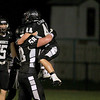 Kaneland's Grant Wooten (15) and Joe Komel (58) celebrate with Cole Carlson (44) after Carlson's interception and touchdown during their home game agains IC Catholic Prep Friday night.