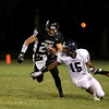 Kaneland's Dylan Nauert carries the ball during their home game agains IC Catholic Prep Friday night.