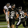 Kaneland's Jesse Balluff (30) celebrates his touchdown with teammate Isaac Swithers (23) during their home game against IC Catholic Prep Friday night in Maple Park.