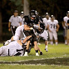 Kaneland's Brandon Bishop is tackled on a punt return during their home game against IC Catholic Prep Friday night in Maple Park.
