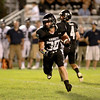 Kaneland's Jesse Balluff carries the ball during their home game agains IC Catholic Prep Friday night.