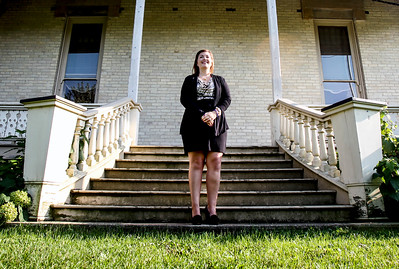 Sarah Nader -  snader@shawmedia.com Erin McElroy, Advancement Coordinator at the Lakeside Legacy Foundation poses for a portrait outside the historic Dole Mansion in Crystal Lake Friday, September 6, 2013. McElroy is responsible for marketing of the three signature events, Lakeside Fest, Run and Roll for the Dole and Christmas at the Dole as well as the First Friday gallery events.