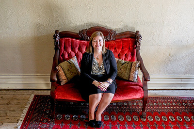 Sarah Nader -  snader@shawmedia.com Erin McElroy, Advancement Coordinator at the Lakeside Legacy Foundation poses for a portrait inside the historic Dole Mansion in Crystal Lake Friday, September 6, 2013. McElroy is responsible for marketing of the three signature events, Lakeside Fest, Run and Roll for the Dole and Christmas at the Dole as well as the First Friday gallery events.