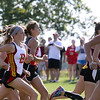Jeff Krage – For Shaw Media<br /> The start of the girls varsity race during Saturday's Leavey Invitational at LeRoy Oakes Forest Preserve in St. Charles.<br /> St. Charles 9/7/13
