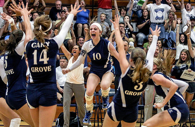 Sarah Nader -  snader@shawmedia.com Cary-Grove's Meghan Seymour celebrates with her teammates after winning the first game during Tuesday's volleyball match against Prairie Ridge in Cary September 10, 2013. Cary-Grove won, 2-1.