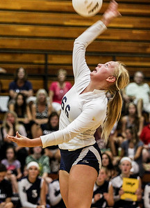 Sarah Nader -  snader@shawmedia.com Cary-Grove's Delaney Bayer returns the ball during Tuesday's volleyball match against Prairie Ridge in Cary September 10, 2013. Cary-Grove won, 2-1.