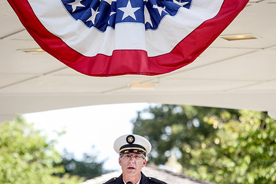 Sarah Nader -  snader@shawmedia.com McHenry Township Fire Protection District Chief Tony Huemann speaks during a commemoration at Veterans Memorial Park in McHenry Wednesday, September 11, 2013 to honor those lost in the Sept. 11 terrorist attacks.