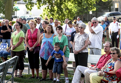 Sarah Nader -  snader@shawmedia.com A moment of silence is observed during a commemoration at Veterans Memorial Park in McHenry Wednesday, September 11, 2013 to honor those lost in the Sept. 11 terrorist attacks.