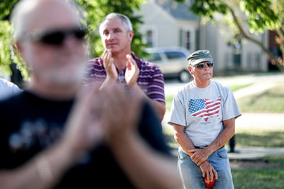 Sarah Nader -  snader@shawmedia.com Jerry Loebbaka (right) of Lakemoor attends attends a commemoration at Veterans Memorial Park in McHenry Wednesday, September 11, 2013 to honor those lost in the Sept. 11 terrorist attacks.