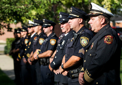 Sarah Nader -  snader@shawmedia.com Deputy Fire Chief Rudy Horist (right) stands with McHenry Township Fire Protection personnel and McHenry Police officers at Veterans Memorial Park Wednesday, September 11, 2013 to honor those lost in the Sept. 11 terrorist attacks.