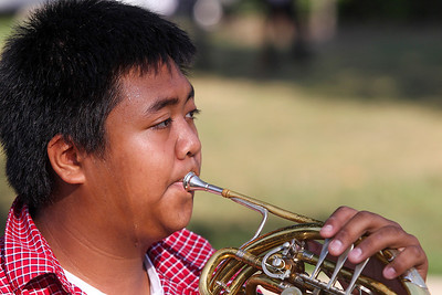 Sarah Nader -  snader@shawmedia.com McHenry's Jeremy Sacramento plays the French horn with the McHenry High School band during a commemoration at Veterans Memorial Park in McHenry Wednesday, September 11, 2013 to honor those lost in the Sept. 11 terrorist attacks.