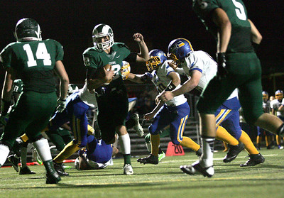 Kyle Grillot - kgrillot@shawmedia.com  Grayslake senior Alex Lennartz runs the ball in for a touchdown in the second quarter of the football game at Grayslake Central Thursday, September 12, 2013. Johnsburg lost the game 21-28.